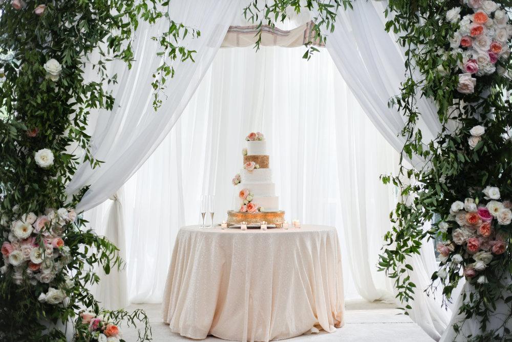 metallic wedding cake greenery installation