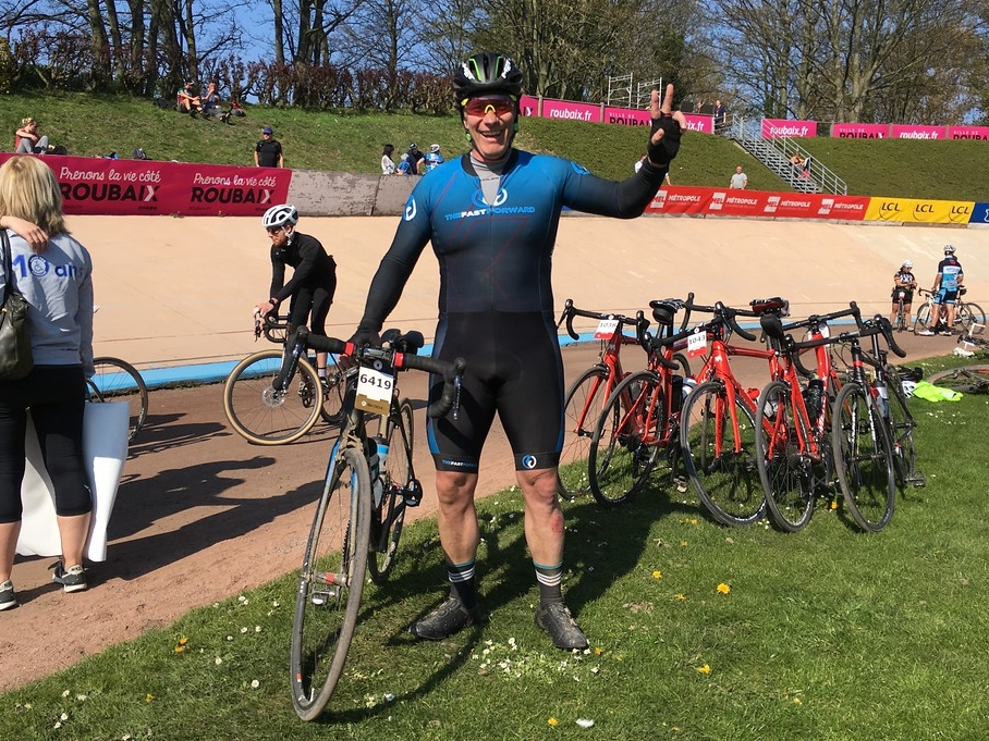 """Team rider Paul Young at the finish of the """"Paris Roubaix citizens race"""""""