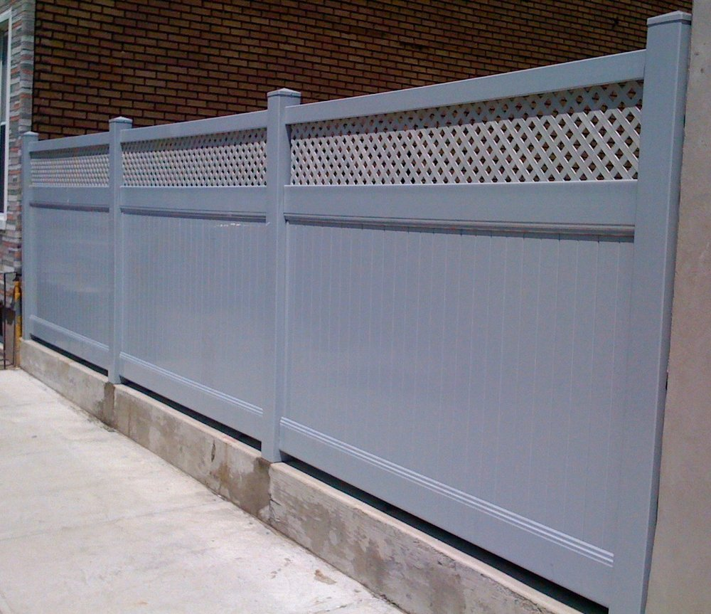 Gray lattice top solid privacy vinyl fence