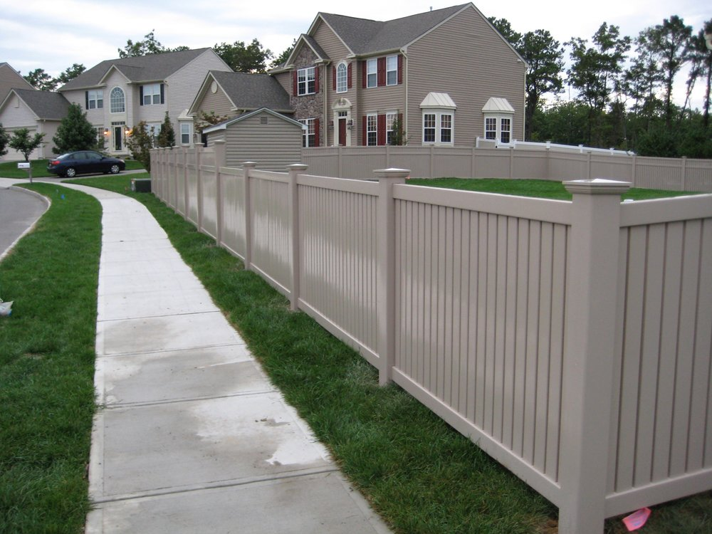 Clay Vinyl fence installation