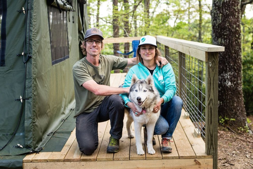 Cashion Smith & Eva Surls the vision and drive behind the bike farm on the deck of the new Glamping Tents.