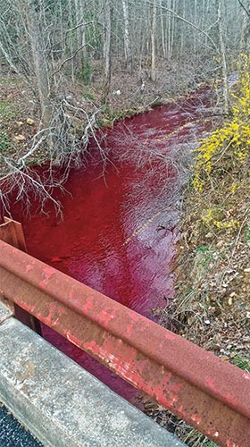 Kentucky's Stoney Fork was discolored in early 2017 by a leak of Potassium Permanganate, a chemical used in treating Acid Mine drainage.