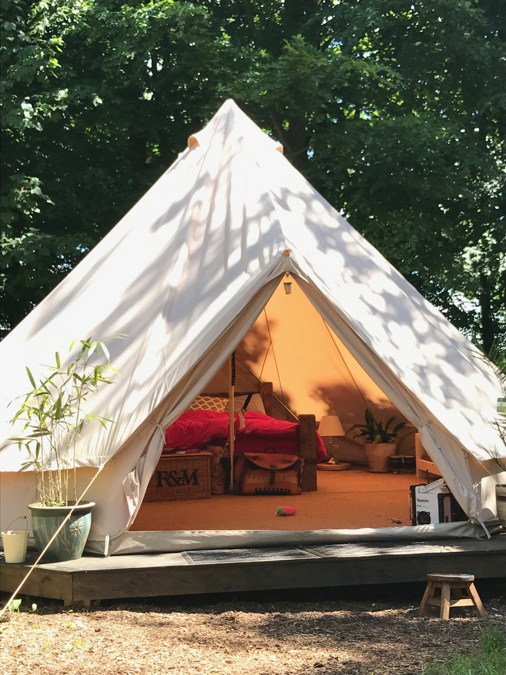 our Spacious King Bell Tent is an under canvas experience for the whole family. Beautiful dappled light shines throughout and you're surrounded by nature.
