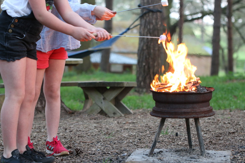 toasting marshmallows of the camp fire Glamping Norfolk