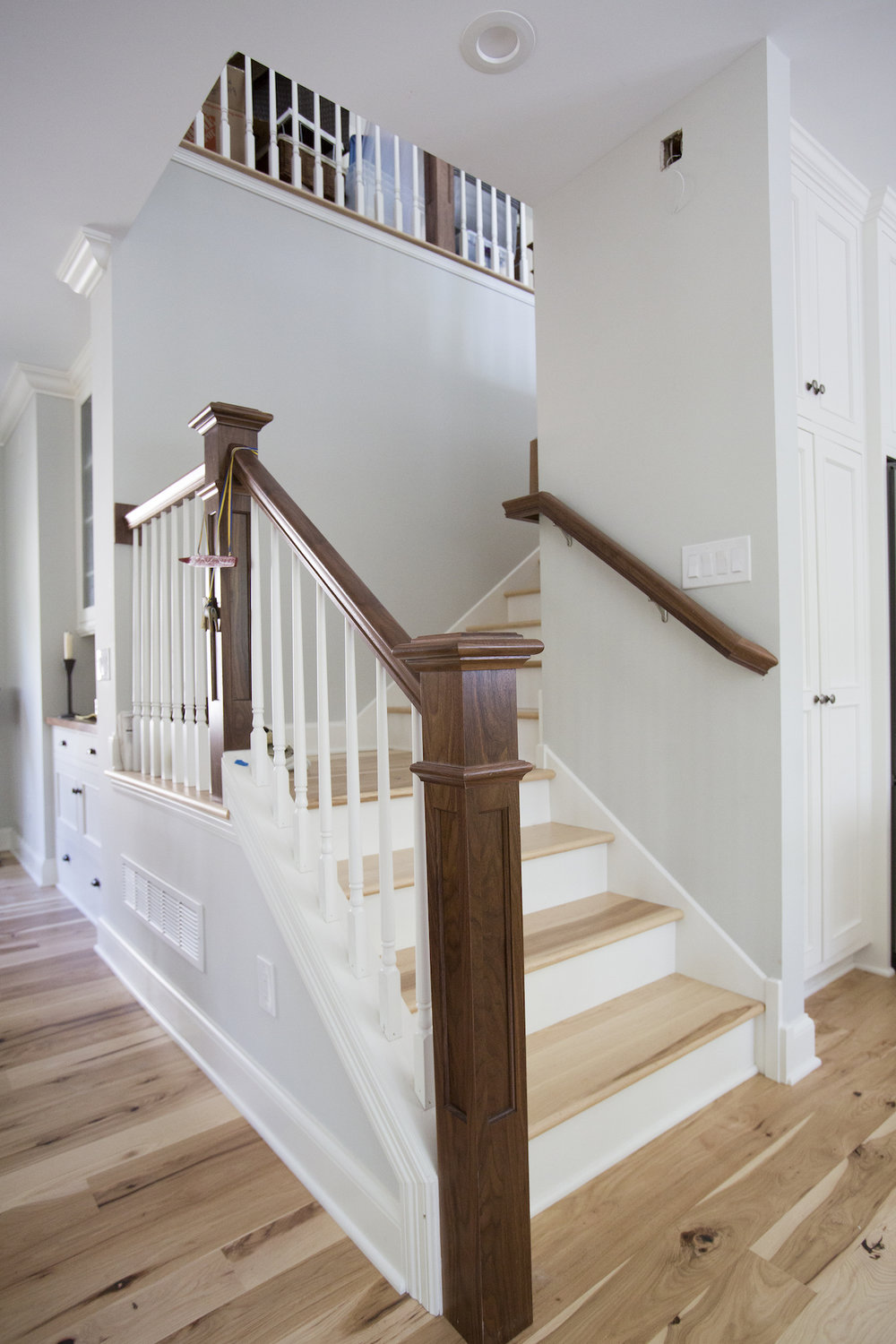 Open concept staircase with hardwood floors