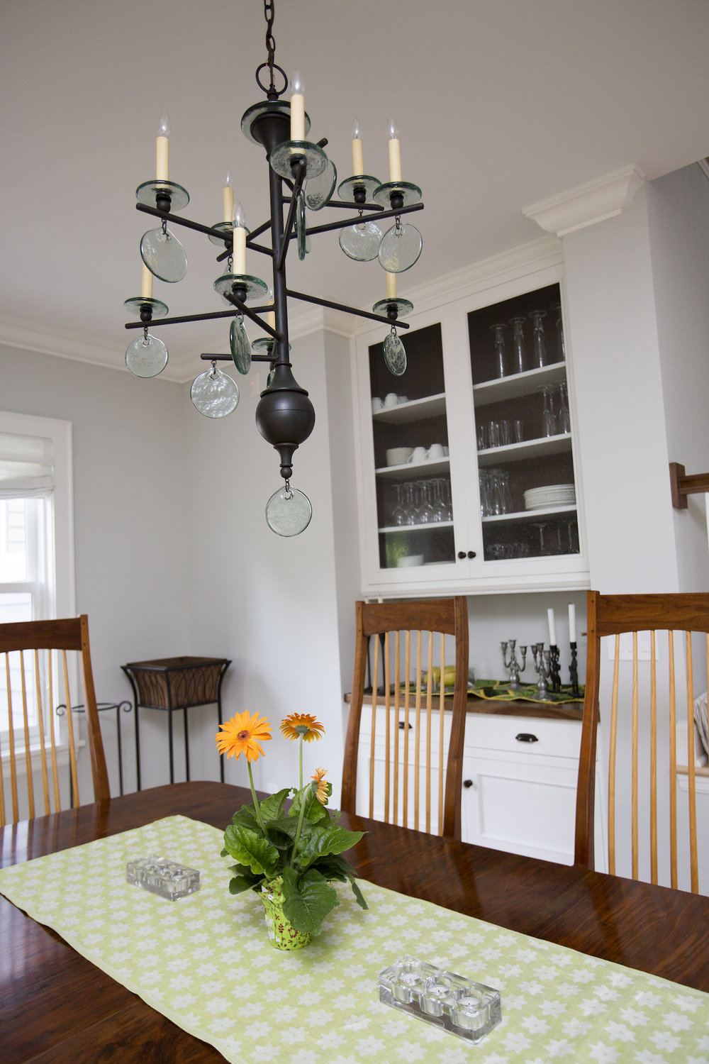 Bright sunny dining room with mid century chandelier