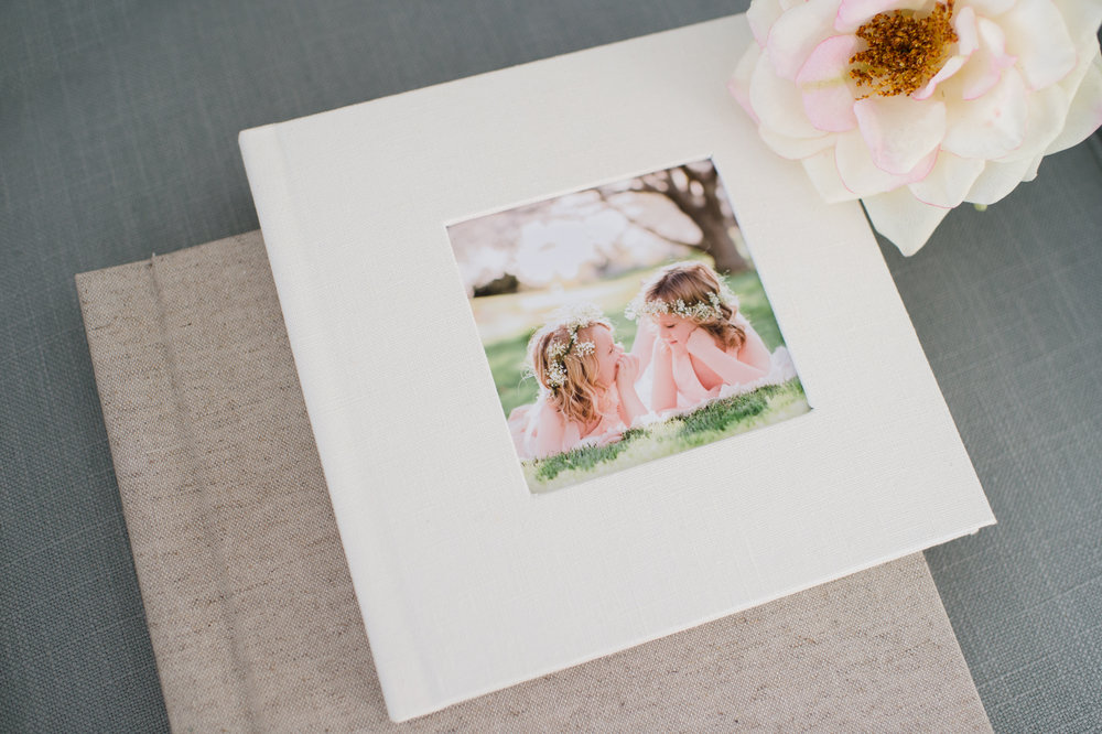 Preserve your favorite memories from your family photography session in a fine art album designed by Sweet Light Portraits. These beautiful albums are hand made in the USA and are the perfect addition to your custom family or child portrait session.