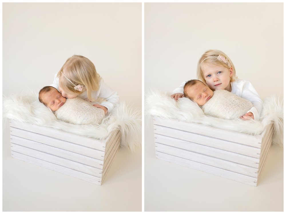 Baby Brother is welcomed by big sister in a custom newborn session by Sweet Light Portraits.