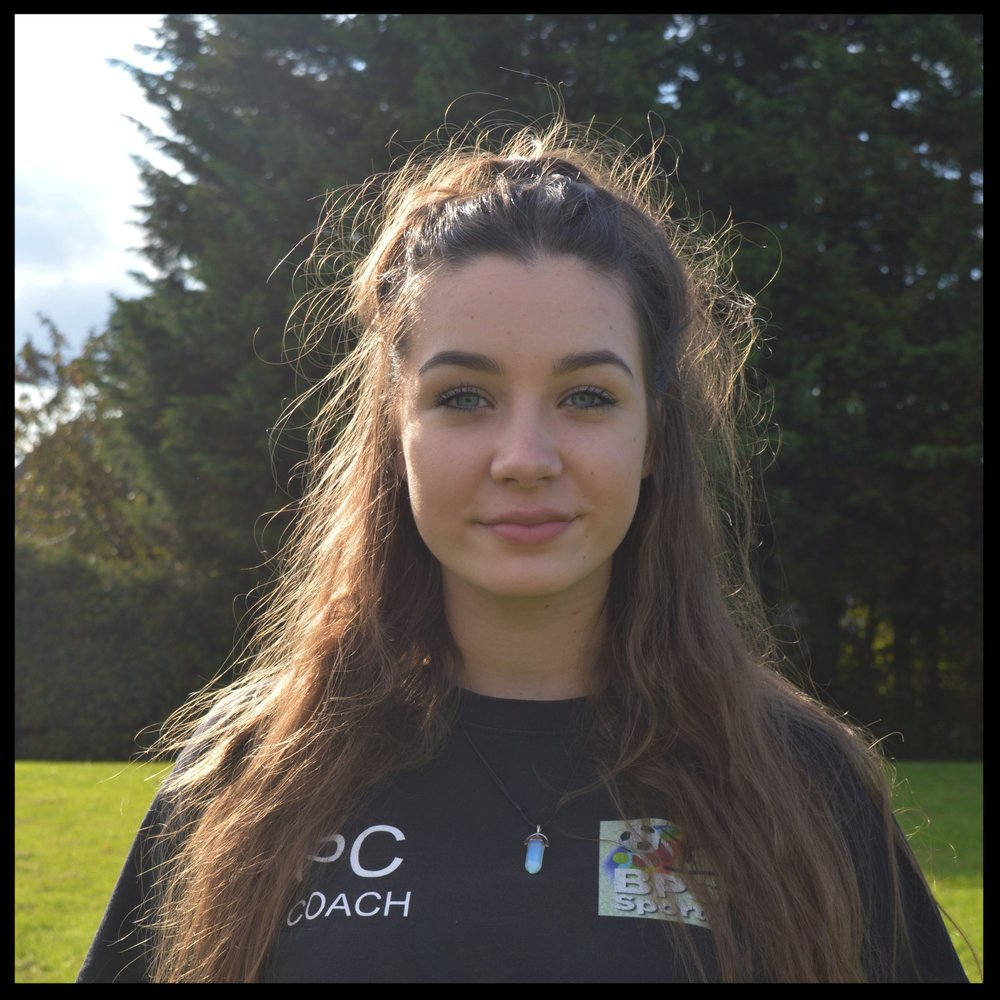 Phoebe Copas - Coach - Phoebe is a year 11 student at Stopsley High School and was previously a student at Bushmead Primary School. She is currently completing her coursework for her GCSE exams which she will take next summer. She has participated in extra curricular activities which include representing her school on various occasions in both primary and high school. For three years she played on the girls netball team as a goal shooter in countless tournaments and matches. Phoebe is also a young leader at brownies which has given her experience working with young children which will be vital for us at BPS Sports. Phoebe coaches at our gymnastics clubs and works 1:1 with the children to help them improve specific techniques. She also works at our Holiday Sports Camps and is developing her skills as a coach by leading sessions and working with some of our other coaches.