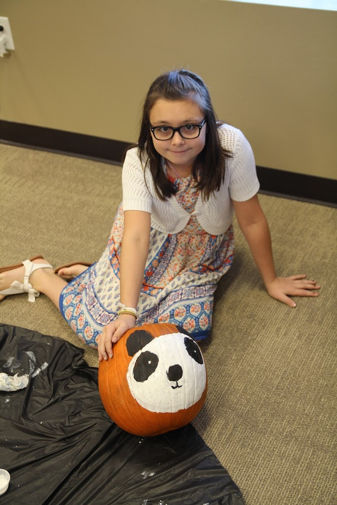 Maci with her panda pumpkin during Sunday  School
