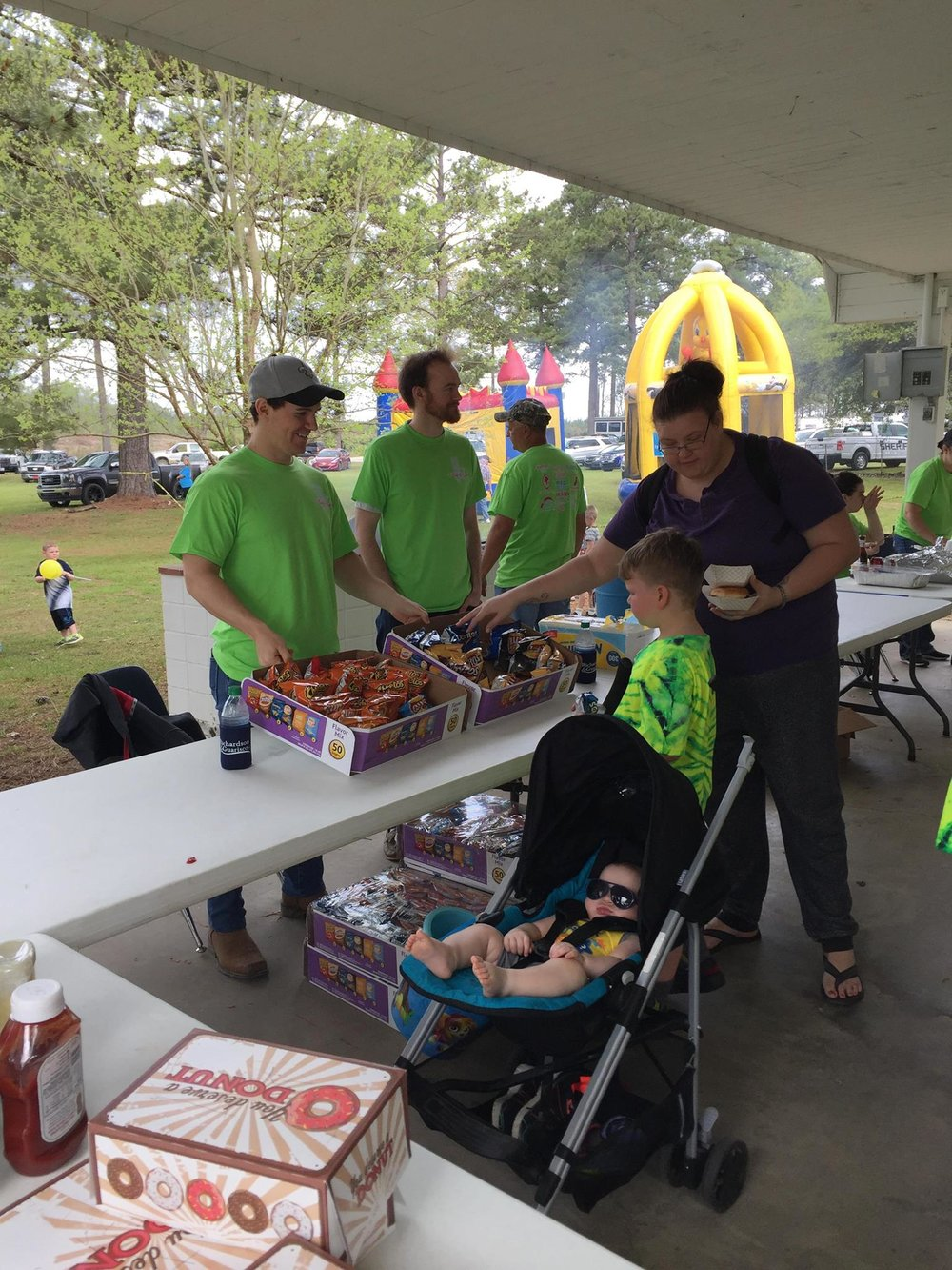 John, Nick, and Rachel volunteered at the annual Easter Egg Hunt Festival in the village of Elizabeth. The three attorneys served chips and cupcakes during a fun-filled day!