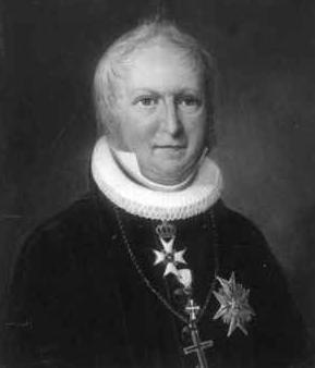 Jacob Neumann satte mange viktige spor etter seg i Asker på begynnelsen av 1800-tallet. I Eplehagen møter vi presten Johannes Høegh, en oppdiktet person inspirert av Neumann. Kilkk påbildet for mer informasjon.
