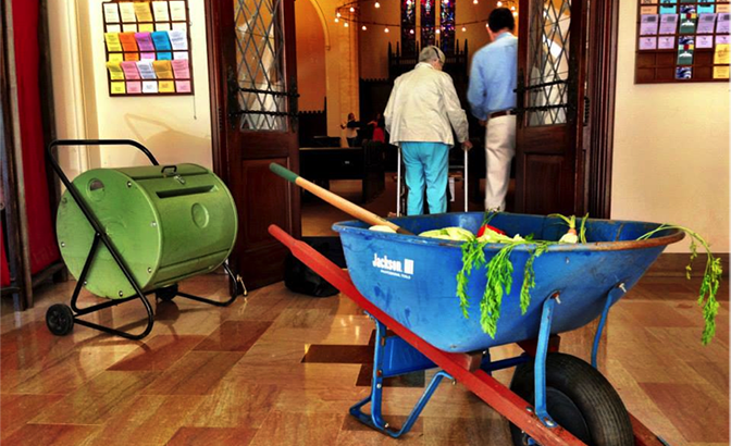 "This wheelbarrow sits outside the sanctuary doors full of compost and veggie scraps. The compost bin is there for people to dump their compost. We are inviting folks into a ""Food and Faith"" practice each week and the first few weeks have been composting—save your compost and bring it to church to dump in bin."