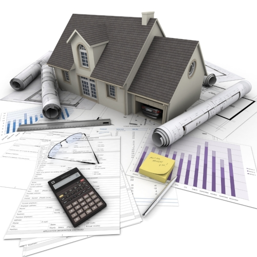 home plans and calculator on a work table