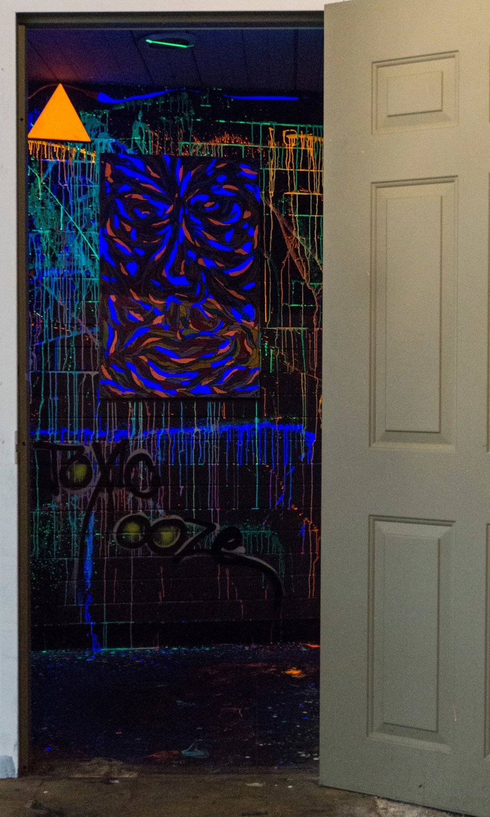 The interactive black light room, where visitors were given their own glow paint to sling on walls.
