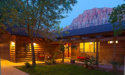 Private Sanctuary   Terraced backyard patios with seating for groups large & small. Majestic views of the brilliant red mountains of Zion National Park soaring 3,000 feet overhead.