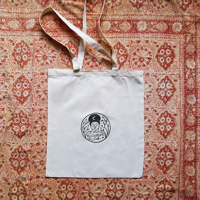 "Here they are, beauties: 100% organic cotton tote bags, each one hand-printed with the Moonbeam Club logo, Now available on @etsyuk + www.themoonbeamclub.com. I LOVE these because they're large enough to fit pretty much anything I need to schelp around (groceries/books/clothes/bits n bobs) but lightweight enough to fold up teensy small in my purse! Plus, they're super cute (how rad is that stamp by @rarepress ?? She's a queen). To celebrate, the next 10 Moonbeam Cream orders will come with a FREE tote! (Dimensions: L 16"" W 24.5"" straps 27"") #plasticfree #lowwaste #lesswaste #zerowaste #noplastic #organic #moonbeamclub #handmade #printing #fabricprinting"