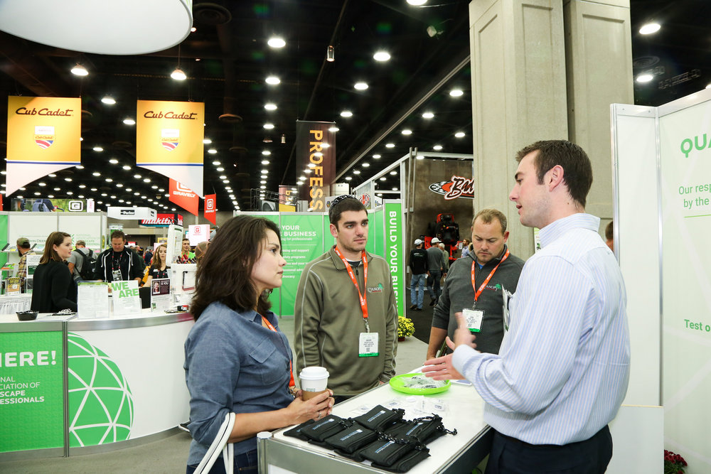Davis Cooper speaking with attendees at the booth