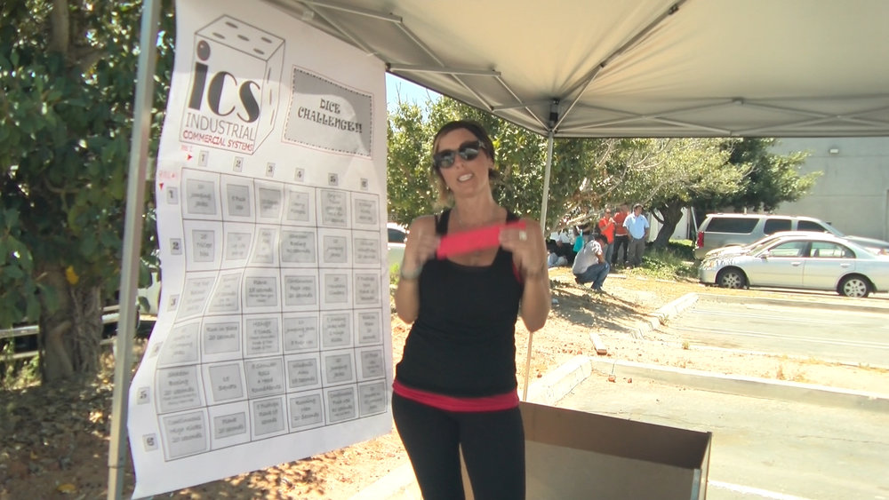 Vanessa Hayes holding red raffle tickets at the Dice Challenge Booth.
