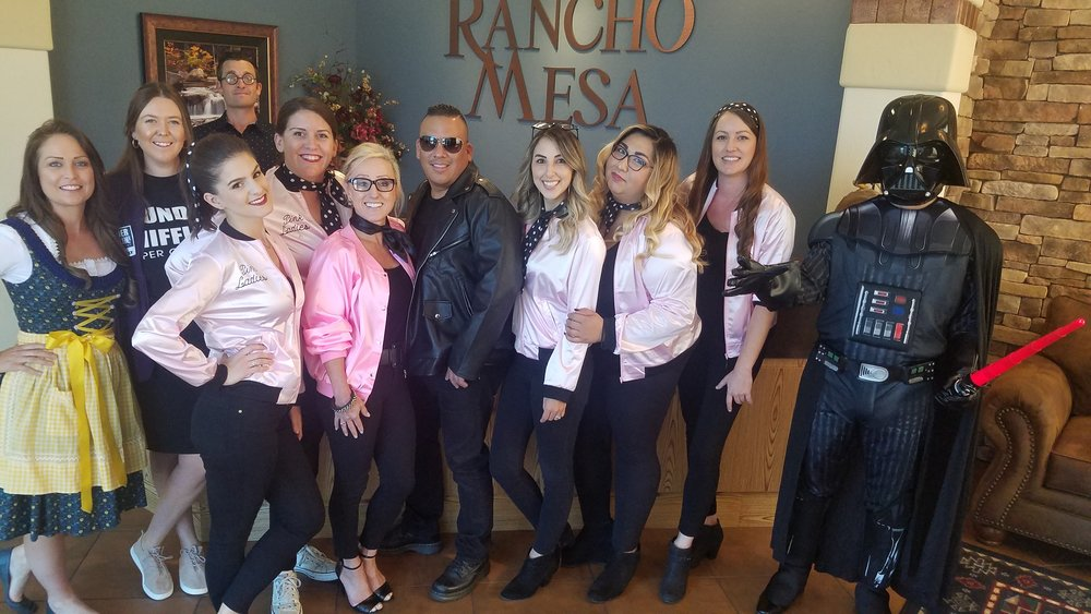 Eleven Rancho Mesa employees wearing Halloween costumes