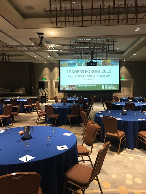 Empty ball room at the Leaders Forum with a giant screen