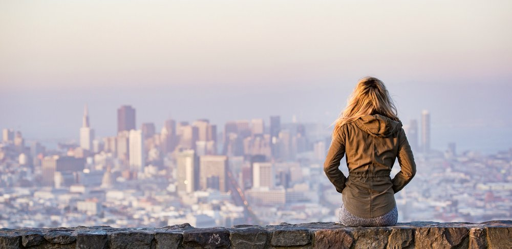 retouched-young-girl-enjoying-moment-and-looking-over-the-city-of-san-francisco.jpg
