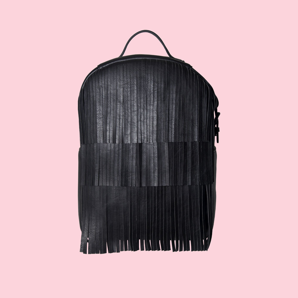 CC   That 70's bag. We think we were born in the wrong decade sometimes so we are making up for lost time with the CC bag. Three layers of front fringe means never a dull work day. So fluff out those Farrah Fawcett bangs and get to work, kids!