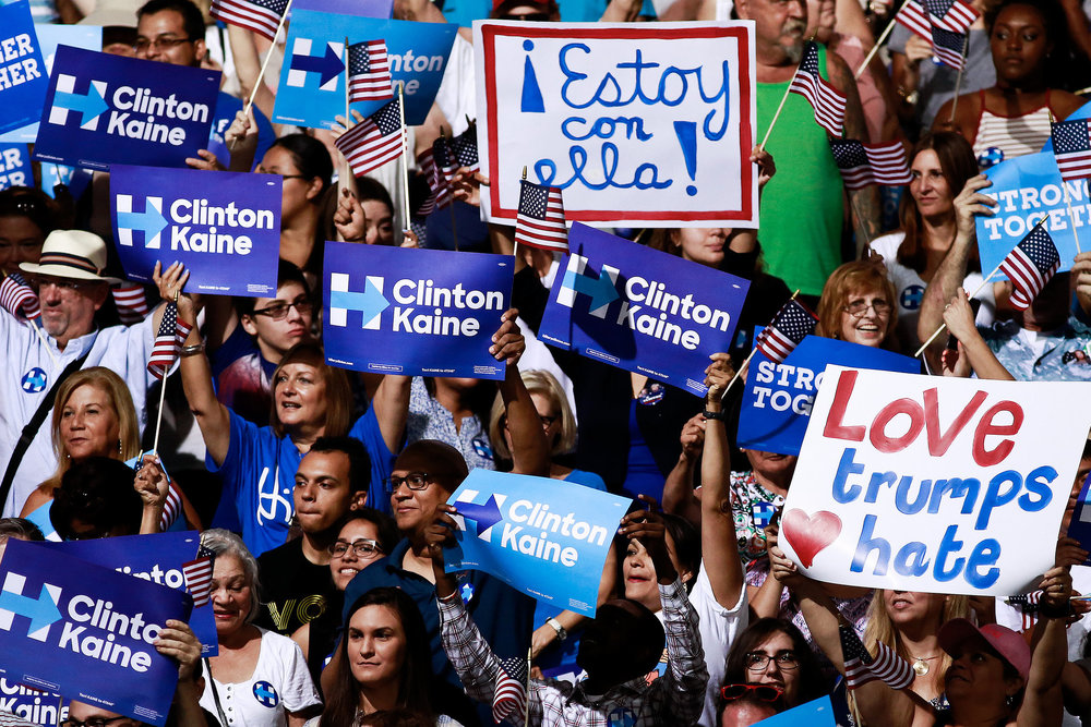 "Signs in English and Spanish, including those saying ""Estoy con ella,"" or ""I'm with her,"" at a rally for Hillary Clinton and Senator Tim Kaine in Miami last month. Scott McIntyre for The New York Times"