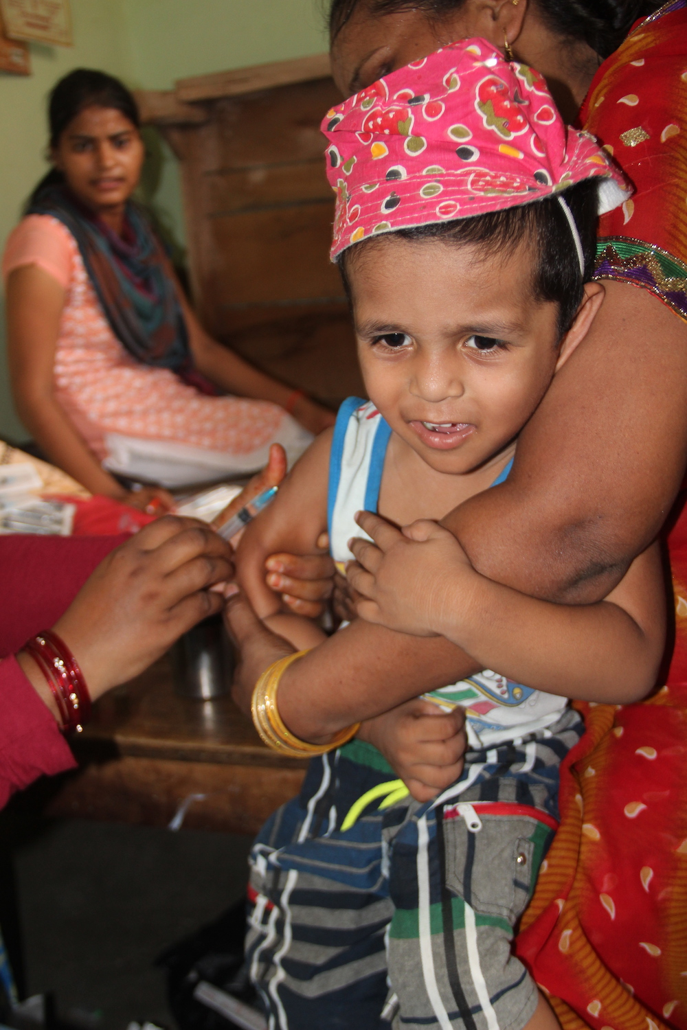 Nurse vaccinating child in Bangladesh