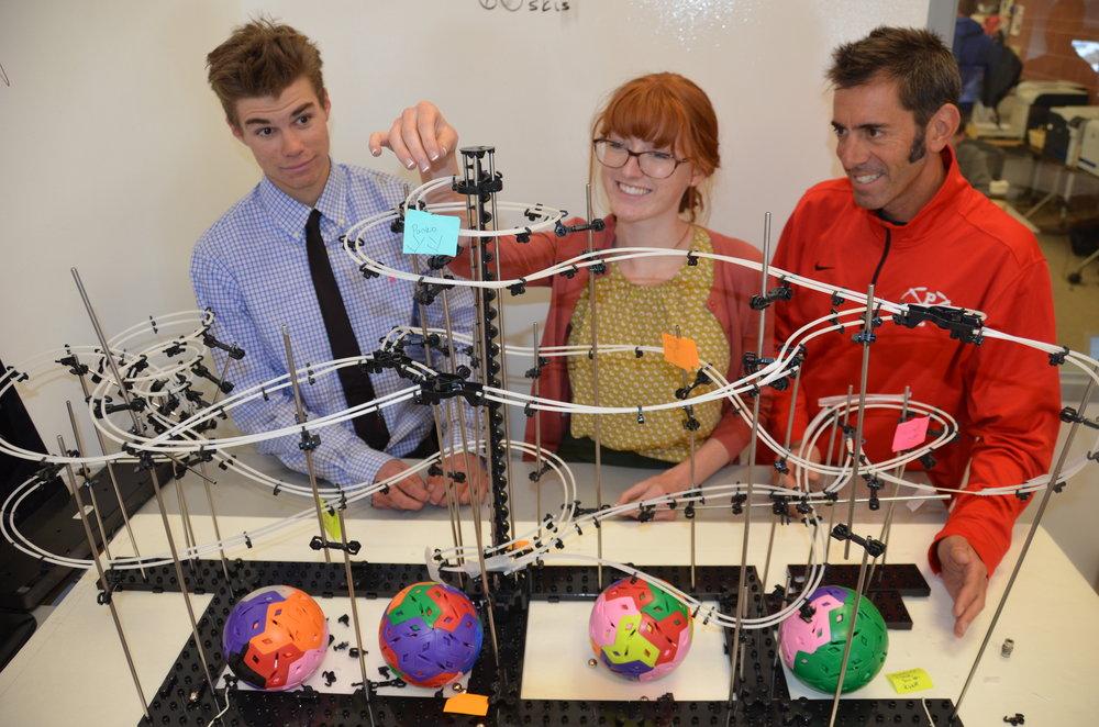 Josh Lansky, Sky Martin, and Chris Humbert working on the kinetic sculpture