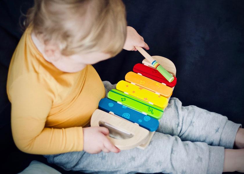 Child playing xylophone