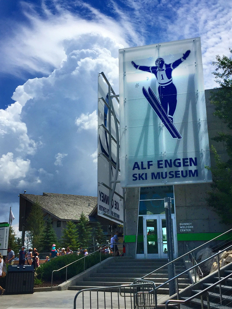 exterior view of Alf Engen Ski Museum with a partially cloudy sky