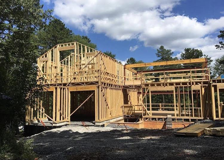 Wood and lumber is added as the house begins to take shape