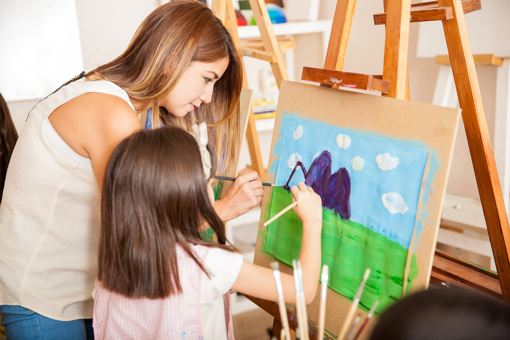 bigstock-Teacher-And-Student-Painting-T-102155435.jpg