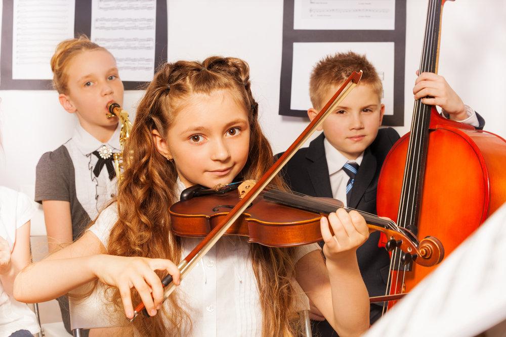 bigstock-Group-of-kids-playing-musical--89914616.jpg