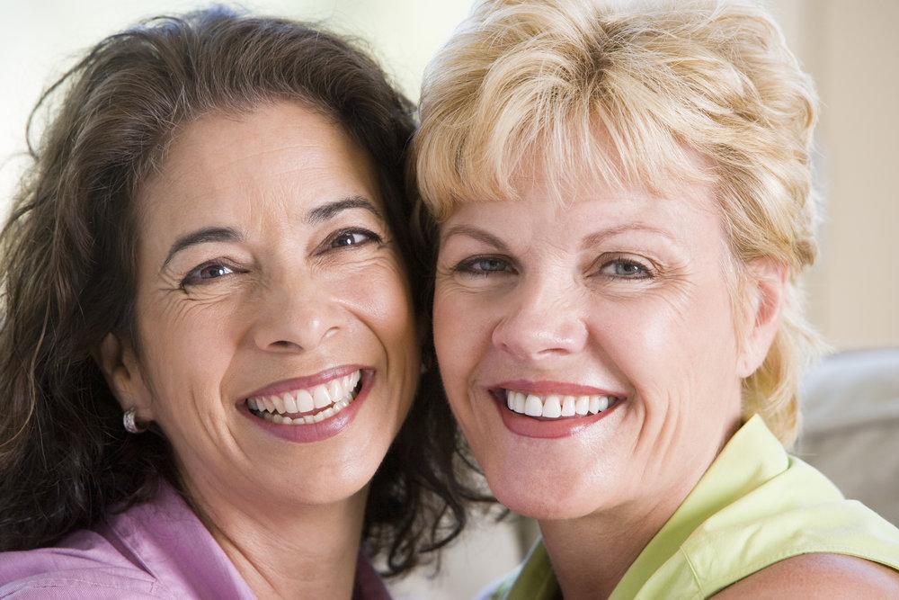 bigstock-Two-Women-In-Living-Room-Smili-4133172.jpg