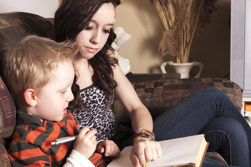 bigstock-A-Babysitter-Writing-something-117691190.jpg
