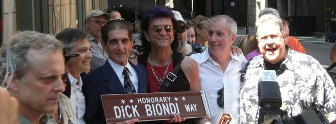 "Dick is surrounded by rock and radio celebs on May 1, 2010 when the Chicago City Council honored him for his longevity in Chicago radio by naming a street in his honor, ""Dick Biondi Way""."