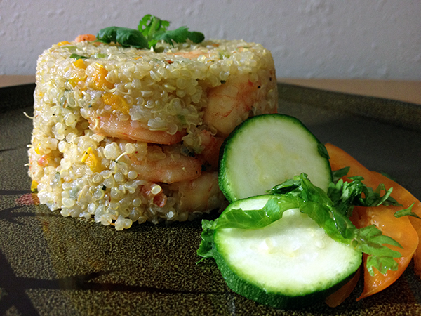 Ingredients   -1 cup uncooked quinoa, rinsed  -1 tbsp Mrs. Dash seasoning blend  -1/4 cup cilantro, chopped  -1/2 cup onion, chopped  -3 garlic cloves, chopped  -1/4 cup tomatoes, chopped  -1/4 cup green bell pepper, chopped  -1/4 cup carrots, diced  -1 pound fresh peeled shrimp  -Salt  -Coconut oil spray   Preparation   -Cook quinoa according to package directions. Set aside.  -Season shrimp with Mrs. Dash seasoning blend.  -Heat a greased skillet on medium-high heat.  -Saute all ingredients with shrimp in the skillet until shrimp are cooked.  -Add the quinoa into the skillet and cook for 5 more minutes.  -Mold, garnish and serve.