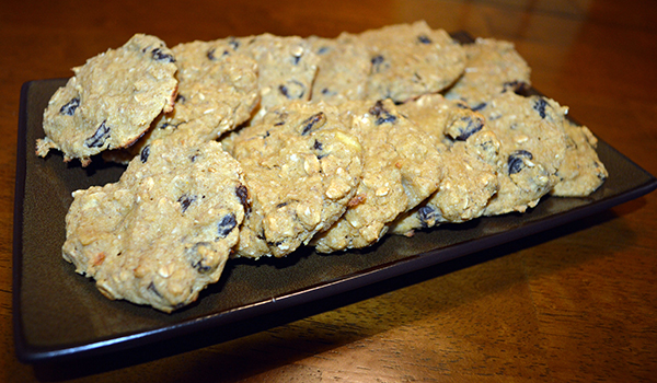 Ingredients -2 cups quick oats -2 eggs -2 medium ripe bananas, mashed -2 scoops of vanilla whey protein powder -3/4 cup raisins -1 tsp cinnamon -1 tsp nutmeg -1 tsp baking soda -1 tsp salt (optional) Preparation -Preheat oven to 350 degrees. -In a large bowl, beat all ingredients (except raisins) with an electric mixer on a medium speed until creamy. -Fold raisins into mixture. -Scoop out mixture with a spoon onto a baking sheet lined with parchment paper. -Bake for 12 – 15 minutes. -Cool for 5 minutes on a cooling rack. Vanilla whey protein powder can be found at the grocery store, but we also sell Poliquin brand protein at Piranha. You can order a tub at our front desk.