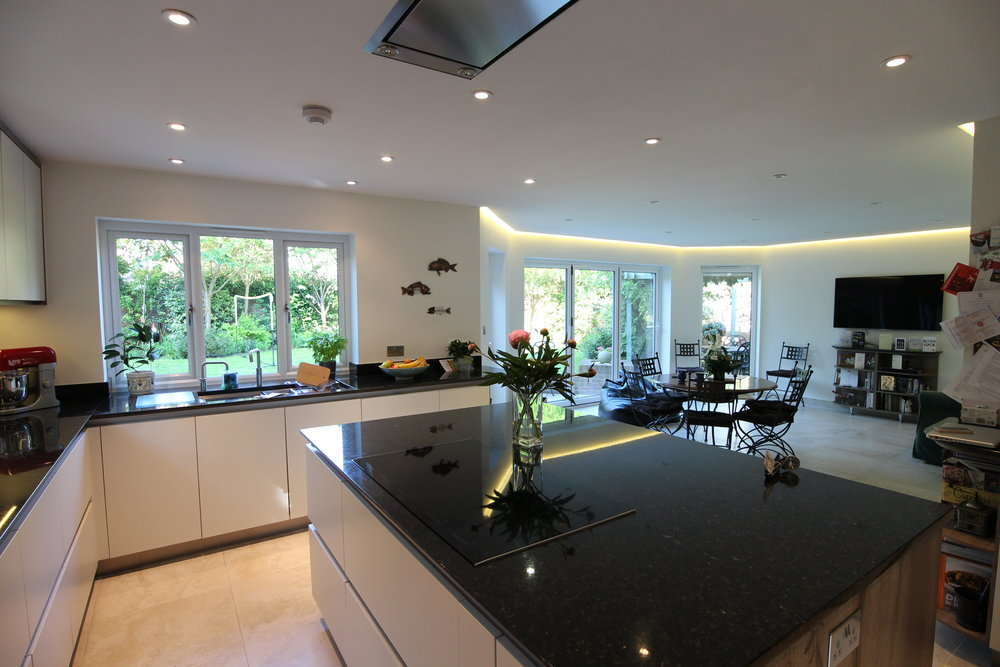 Open-Plan Kitchen   The chef never misses a conversation or goal on TV with this spatial planning!