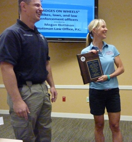 Megan shown above, accepting an award from Roy Denley and  Colorado Police Unity Tour  riders, during a Boulder Sheriff's Office briefing.  (Photo credit: Andrew Tillin).
