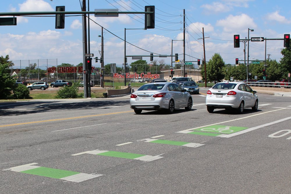 Green pavement markings in Denver notifying motorists of the presence of bicyclists