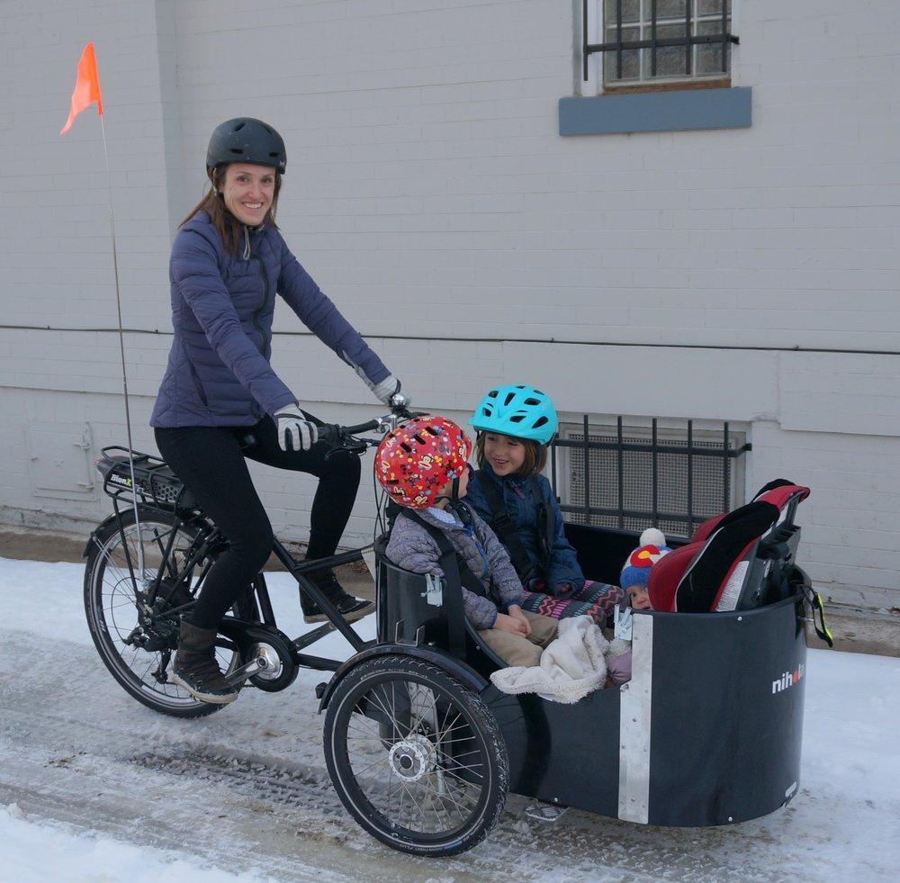 Melissa with kids in cargo bike (1).jpg