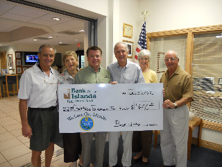Al Hanser delivers his donation to the Charitable Foundation of the Islands.