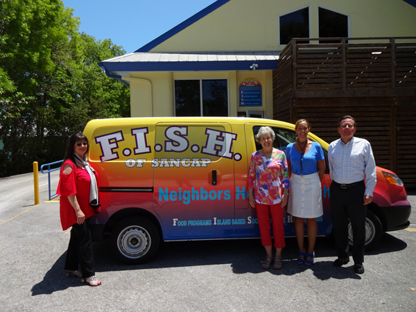 (From left) F.I.S.H. Executive Director Maggie Feiner, CFI Grants Chair Virginia Stringer, F.I.S.H. Board Chair Nichole McHale and Sanctuary Golf Club General Manager Ken Kouril inspect F.I.S.H.'s new delivery van. Photo provided