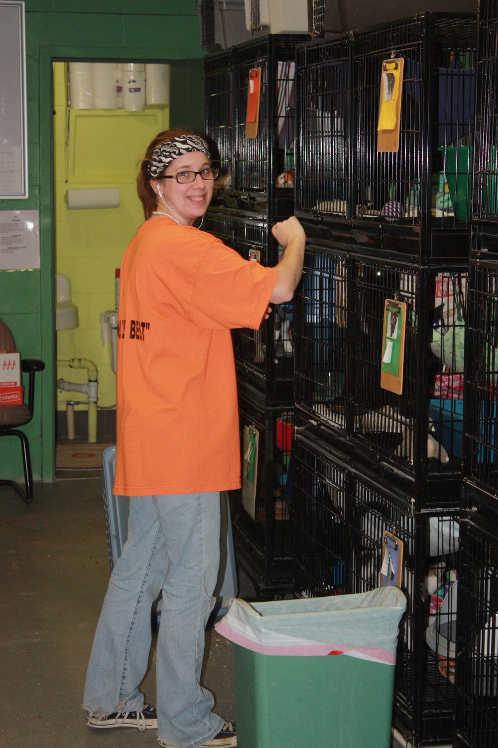 Amanda Volunteer Coordinator and Web Master, cleaning one of our many cat units.