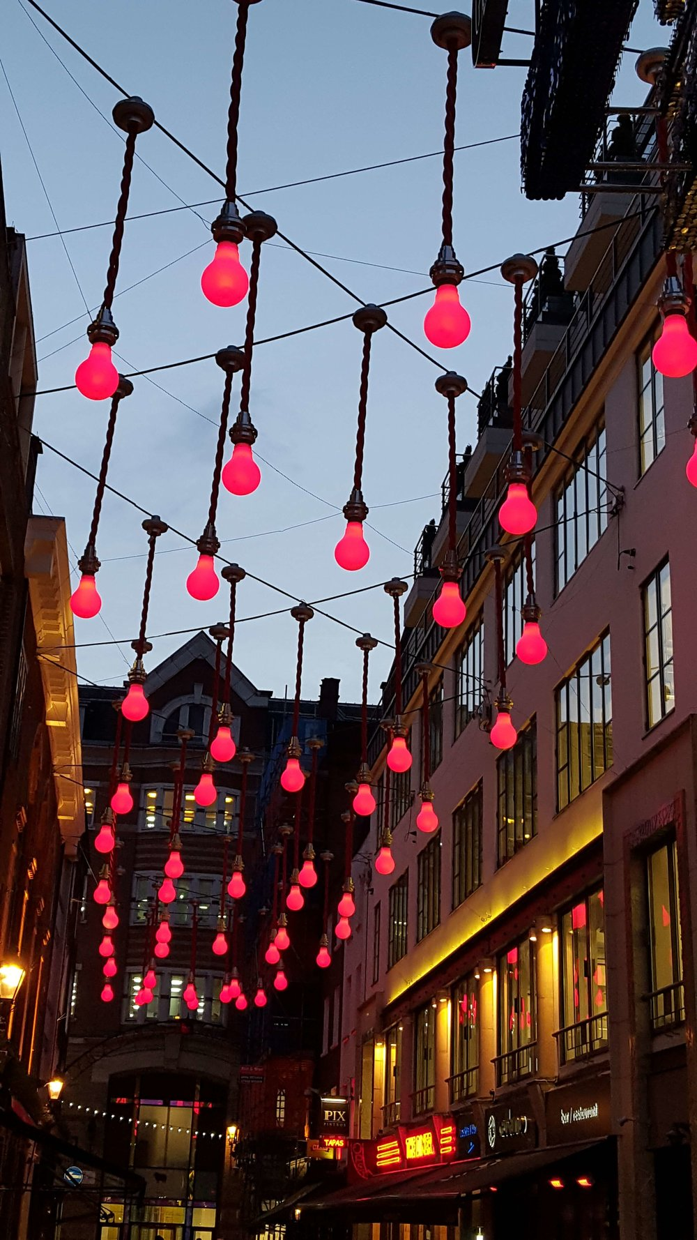 London is a magical place, with inspirational settings for writers. This is an alleyway near Regent's Street covered with red light bulbs. Let your imagination be stimulated in this city, triggering ideas of environments for your own writing.