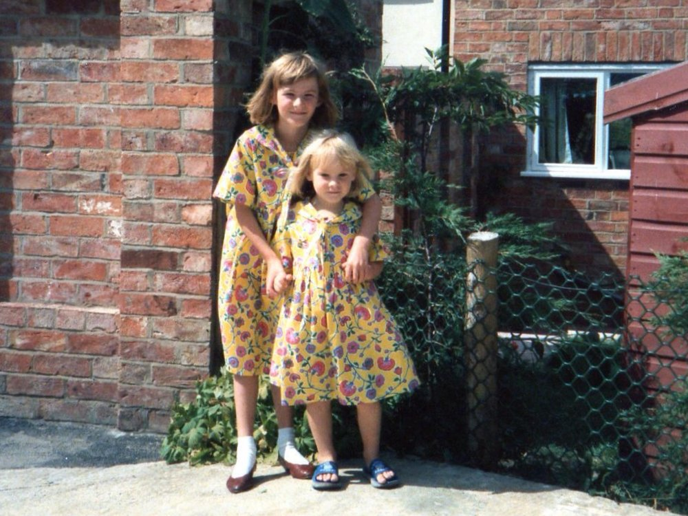 My sister and I - matching Laura Ashley - good work mummy!!