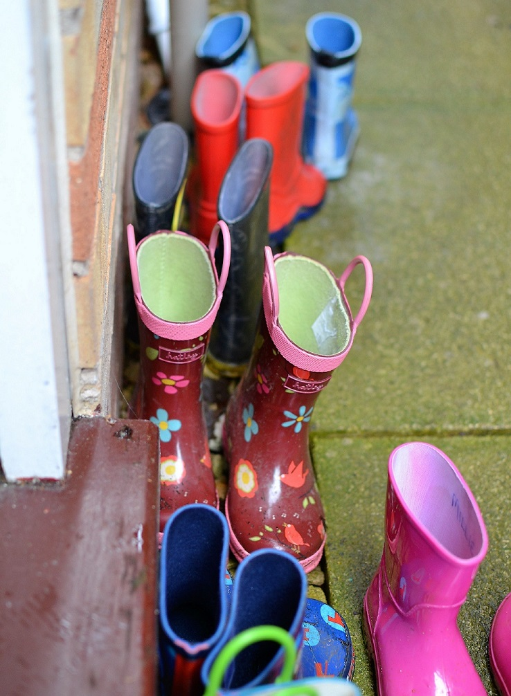 Children's Joules wellie boots along a wall.jpg